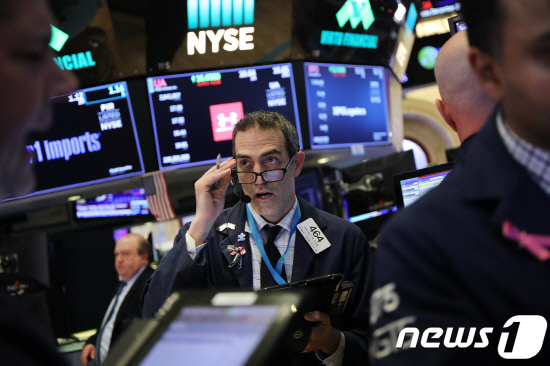 US-MARKETS-REACT-TO-FEDERAL-RESERVE-INTEREST-RATE-ANNOUNCEMENT