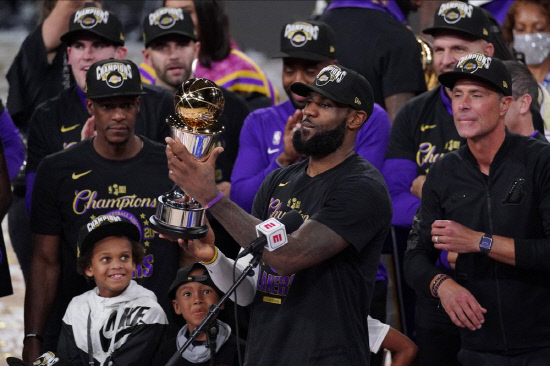 LeBron James (23) holds the MVP trophy