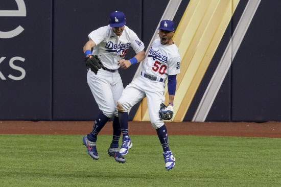 Mookie Betts celebrates with center fielder Cody Bellinger