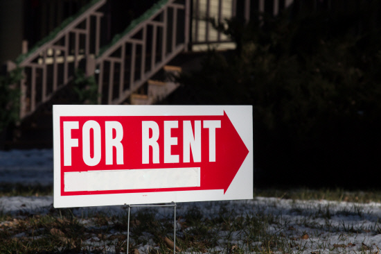 For Rent sign in front of a home